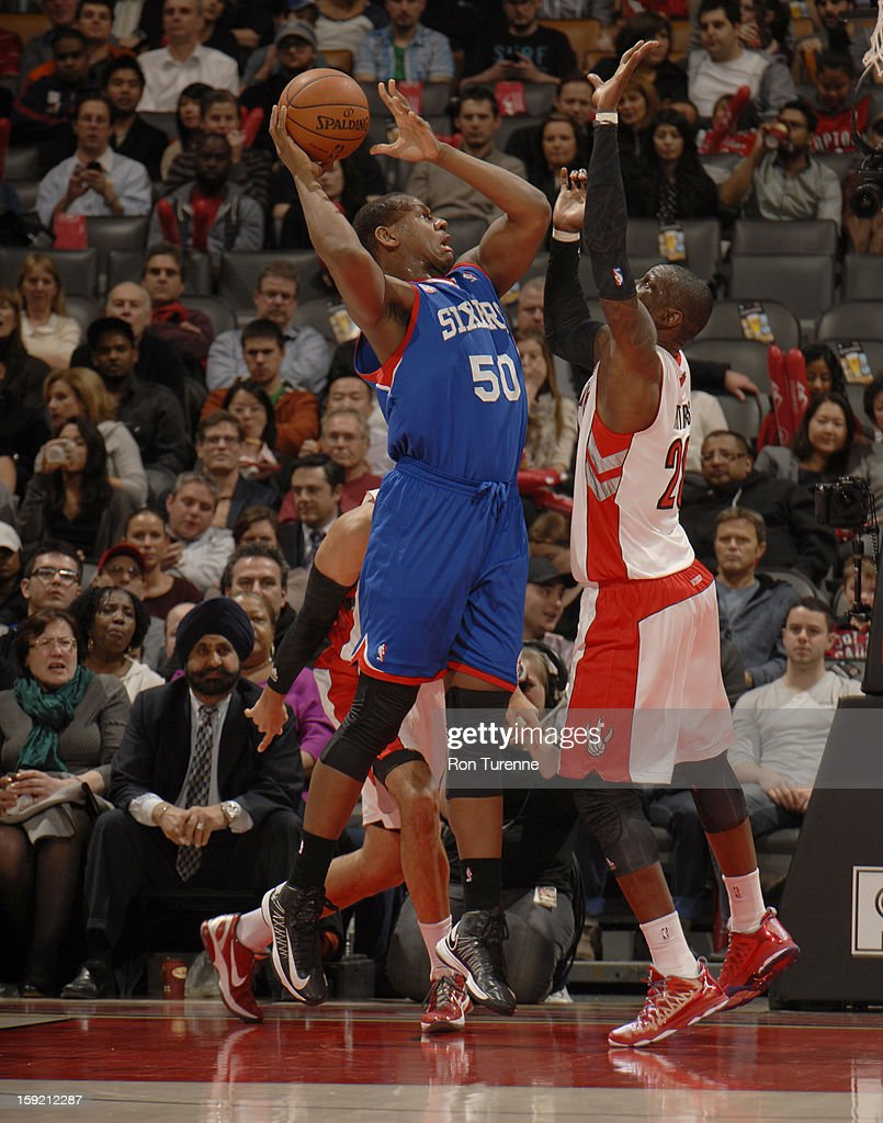 Lavoy Allen #50 of the Philadelphia 76ers goes up for the shot against Toronto Raptors Mickael Pietrus #20 during the game on January 9, 2013 at the Air Canada Centre in Toronto, Ontario, Canada.