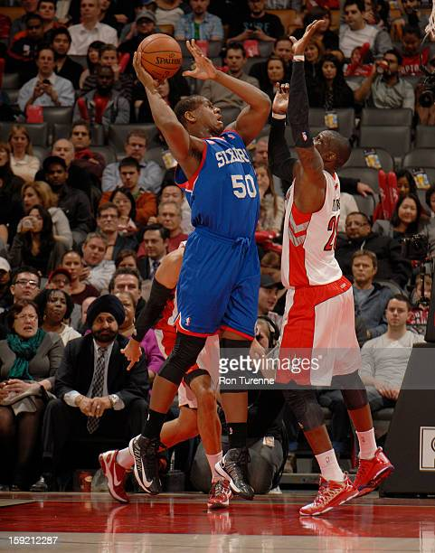 Lavoy Allen of the Philadelphia 76ers goes up for the shot against Toronto Raptors Mickael Pietrus during the game on January 9 2013 at the Air...
