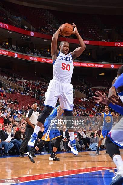 Lavoy Allen of the Philadelphia 76ers grabs a rebound against the Golden State Warriors at the Wells Fargo Center on November 4 2013 in Philadelphia...