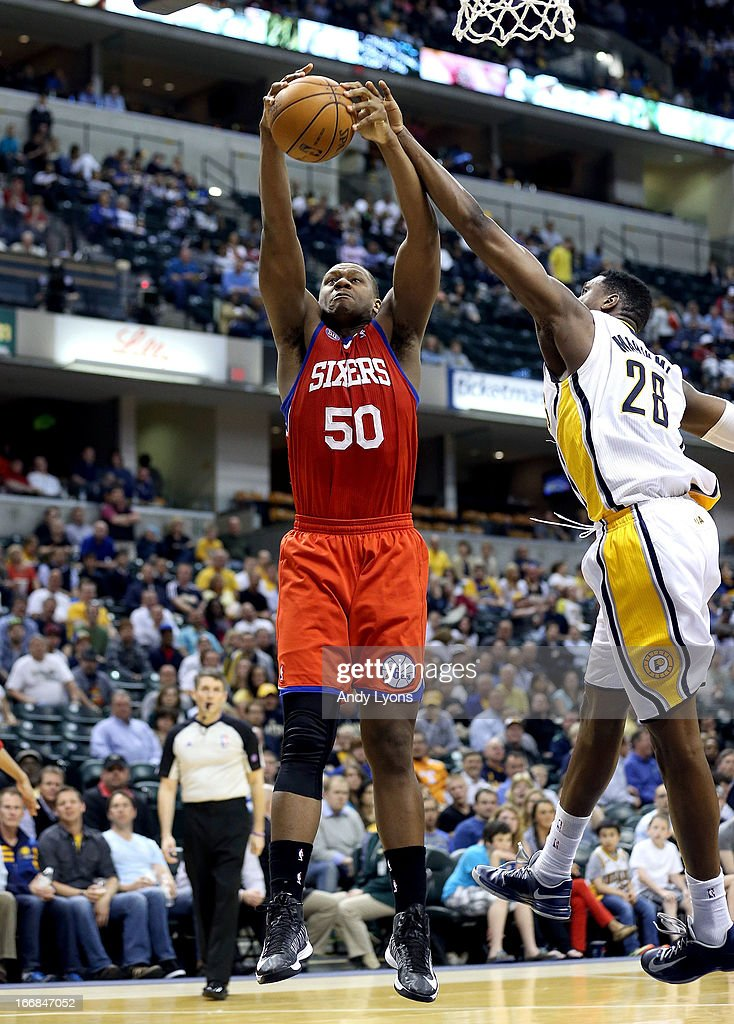 Lavoy Allen #50 of the Philadelphia 76ers reaches for a rebound during the game against the Indiana Pacers at Bankers Life Fieldhouse on April 17, 2013 in Indianapolis, Indiana.NOTE