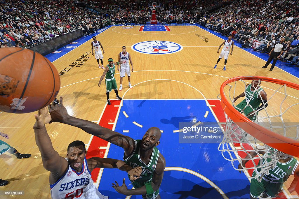 Lavoy Allen #50 of the Philadelphia 76ers shoots against Kevin Garnett #5 of the Boston Celtics on March 5, 2013 at the Wells Fargo Center in Philadelphia, Pennsylvania.