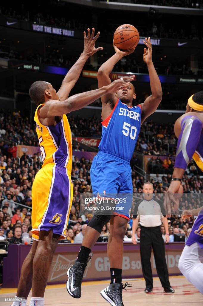 Lavoy Allen #50 of the Philadelphia 76ers shoots against Metta World Peace #15 of the Los Angeles Lakers at Staples Center on January 1, 2013 in Los Angeles, California.