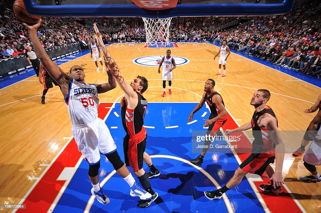 Lavoy Allen #50 of the Philadelphia 76ers shoots the ball against Andrea Bargnani #7 of the Toronto Raptors during the game at the Wells Fargo Center on November 20, 2012 in Philadelphia, Pennsylvania.