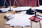 Law act on old wooden desk in library, law officeLaw act on old wooden desk in library, law office