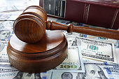 Legal gavel with cash and law book