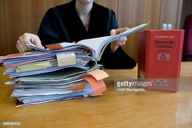 Law Books and court records on a table in the courtroom Hands of a Judge