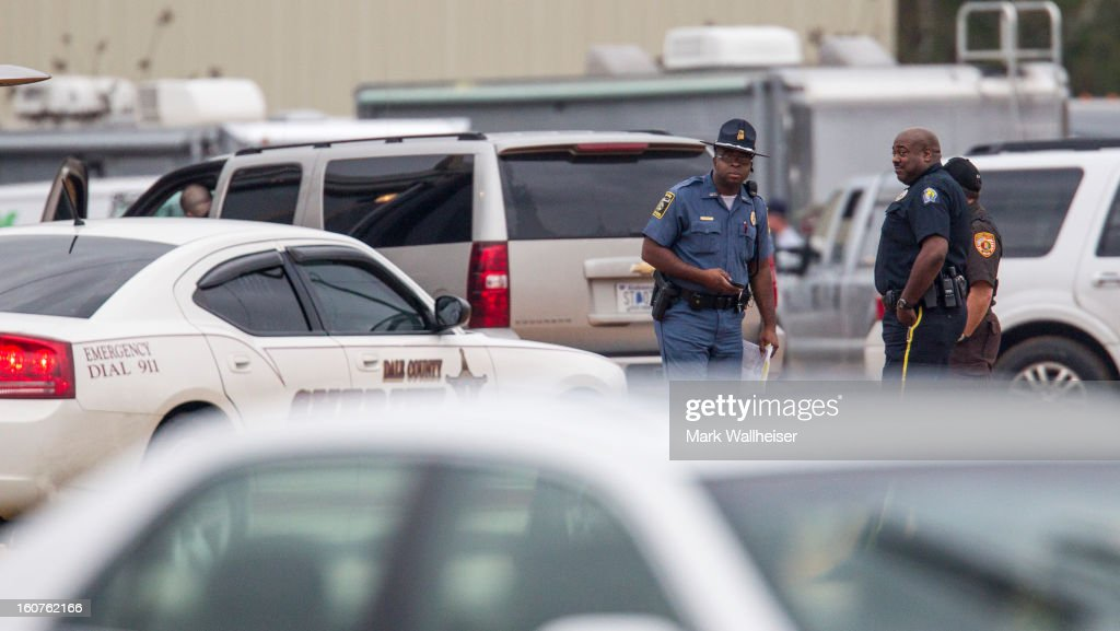 Law enforcement arrive at the staging area to prepare to process the hostage bunker scene just after dawn February 5, 2013 in Midland City, Alabama. The suspect, Jimmy Lee Dykes was killed when the FBI stormed the bunker and rescued the 5 year-old child named Ethan after 6 days of captivity.