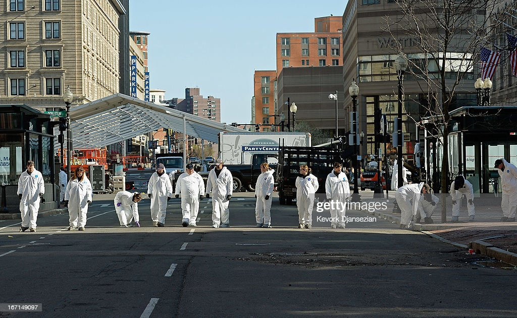 Law enforcement investigators walk near the finsh line of the Boston Marathon on Boylston Street looking for evidence after last Monday's bombings and two days after the second suspect was captured on April 21, 2013 in Boston, Massachusetts. A manhunt for Dzhokhar A. Tsarnaev, 19, a suspect in the Boston Marathon bombing ended after he was apprehended on a boat parked on a residential property in Watertown, Massachusetts. His brother Tamerlan Tsarnaev, 26, the other suspect, was shot and killed after a car chase and shootout with police. The bombing, on April 15 at the finish line of the marathon, killed three people and wounded at least 170.