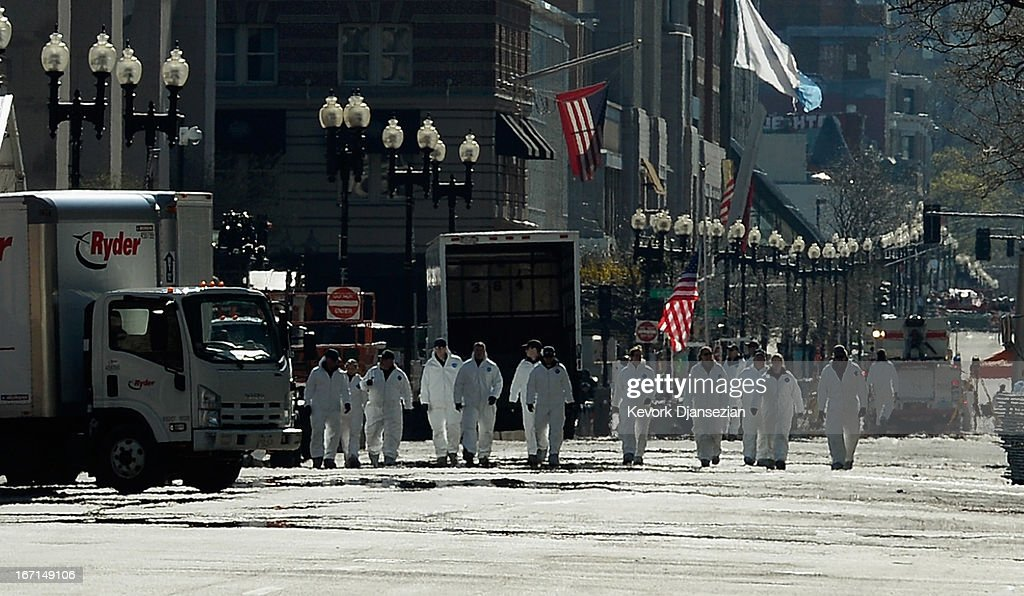 Law enforcement investigators walk the route of the Boston Marathon on Boylston Street looking for evidence after last Monday's bombings and two days after the second suspect was captured on April 21, 2013 in Boston, Massachusetts. A manhunt for Dzhokhar A. Tsarnaev, 19, a suspect in the Boston Marathon bombing ended after he was apprehended on a boat parked on a residential property in Watertown, Massachusetts. His brother Tamerlan Tsarnaev, 26, the other suspect, was shot and killed after a car chase and shootout with police. The bombing, on April 15 at the finish line of the marathon, killed three people and wounded at least 170.