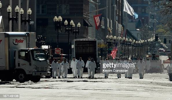 Law enforcement investigators walk the route of the Boston Marathon on Boylston Street looking for evidence after last Monday's bombings and two days...