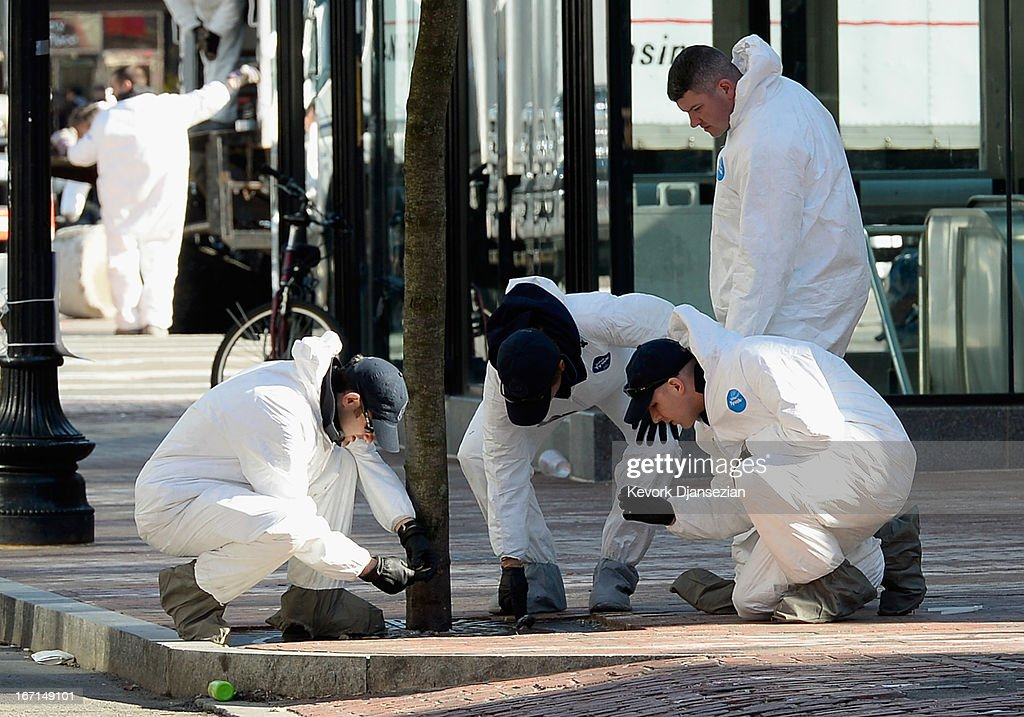 Law enforcement investigators work near the finsh line of the Boston Marathon on Boylston Street looking for evidence after last Monday's bombings and two days after the second suspect was captured on April 21, 2013 in Boston, Massachusetts. A manhunt for Dzhokhar A. Tsarnaev, 19, a suspect in the Boston Marathon bombing ended after he was apprehended on a boat parked on a residential property in Watertown, Massachusetts. His brother Tamerlan Tsarnaev, 26, the other suspect, was shot and killed after a car chase and shootout with police. The bombing, on April 15 at the finish line of the marathon, killed three people and wounded at least 170.