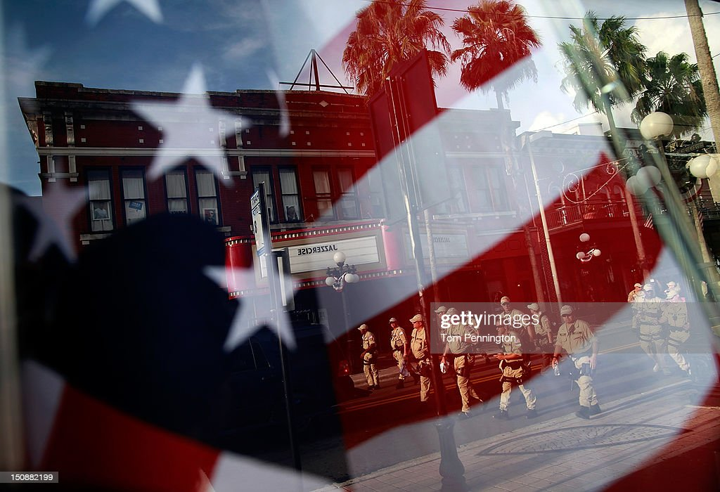 Law enforcement officers are reflected in a storefront window as they clear a downtown street during an organized protest on the first full day of the Republican National Convention at the Tampa Bay Times Forum on August 28, 2012 in Tampa, Florida. The Republican party delegates were prepared to affirm Mitt Romney as the party's nominee as the convention began its first full session after the start was delayed due to Hurricane Isaac.