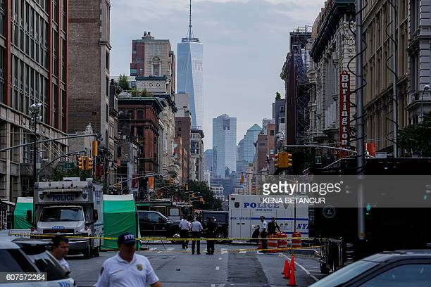Law Enforcement Officers are seen at the scene of an explosion on West 23rd Street September 2016 in New York An explosion rocked one of the most...