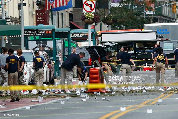 TOPSHOT Law Enforcement Officers are seen at the scene of an explosion on West 23rd Street September 2016 in New York An explosion rocked one of the...