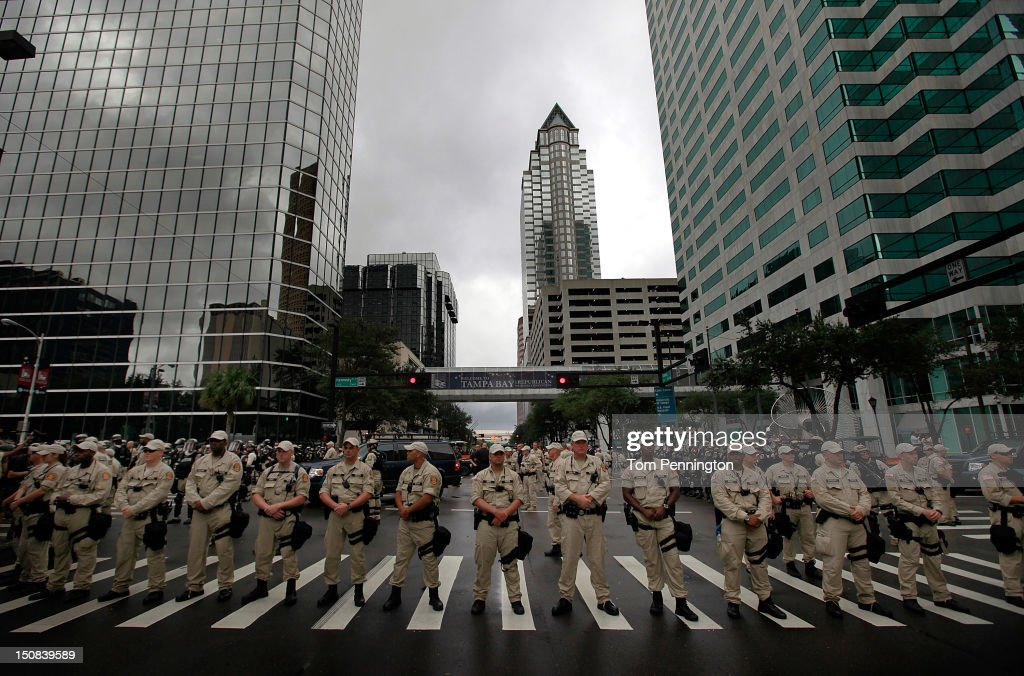 Law enforcement officers block a downtown street during a protest on August 27, 2012 in Tampa, Florida. The demonstration was being held just before of the start of the Republican's nominating convention which will hold its first session on August 28. The convention was scheduled to start on August 27 but was pushed back one day as Tropical Storm Isaac threatens to hit the Tampa area.
