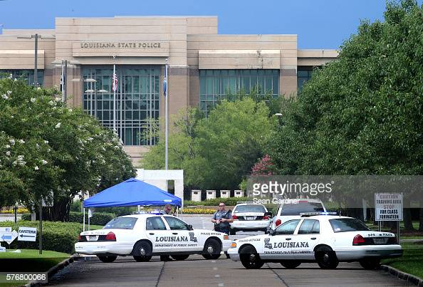 Law enforcement officers block the entrance to the Louisiana State Police headquarters after 3 police officers were killed early this morning on July...