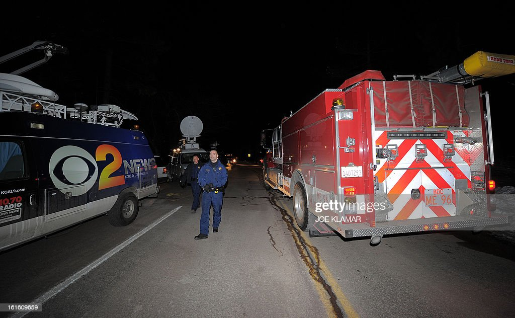 Law enforcement officers check fire engine passing through a roadblock near Angeles Oaks during a standoff with fugitive ex-cop Christopher Dorner, near San Bernardino, California on February 12, 2013. Nobody has yet been found in a burnt-out US mountain cabin where Dorner was believed to have barricaded himself after a six-day manhunt, a police spokesman said. Media reports that a body had been found in the cabin near Big Bear, east of Los Angeles, and identified as Dorner's were false, said Los Angeles Police Department (LAPD) spokesman Andrew Smith.