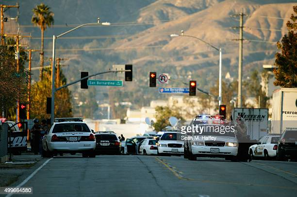 Law enforcement officers close Mountain View Avenue during the pursuit of suspects in the shooting at the Inland Regional Center on December 2 2015...