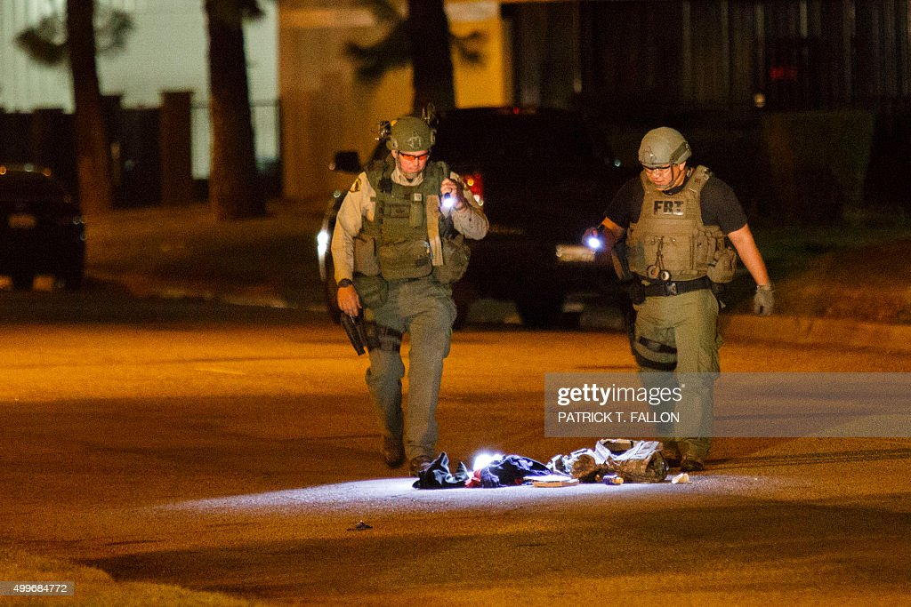 Law enforcement officers investigate a suspicious bag later found not to be a threat on Victoria Avenue after a mass shooting at the Inland Regional...