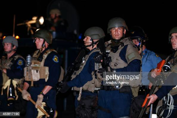 Law enforcement officers patrol during a protest on August 18 2014 for Michael Brown who was killed by a police officer on August 9 in Ferguson...