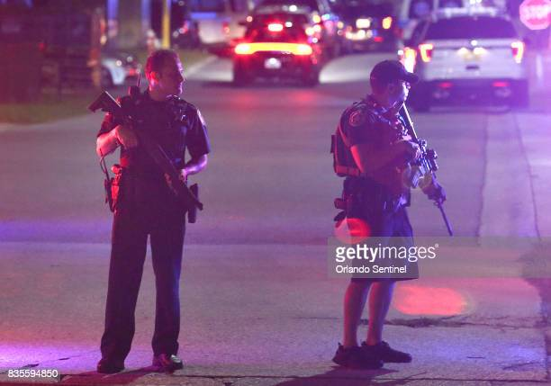 Law enforcement officers stand guard outside Osceola Regional Medical Center in Kissimmee Fla after two Kissimmee Police officers were shot on Friday...