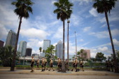 Law enforcement officers walk though the streets as they provide security for the Republican National Convention being held at the Tampa Bay Times...
