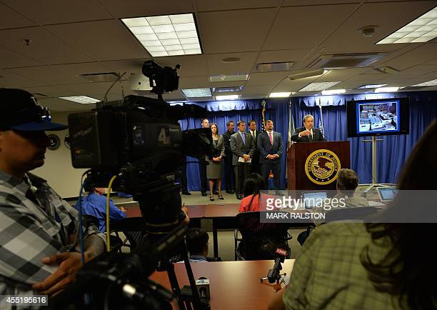 Law enforcement officials brief the media after raids were conducted on moneylaundering operations in the Fashion District of Los Angeles on...