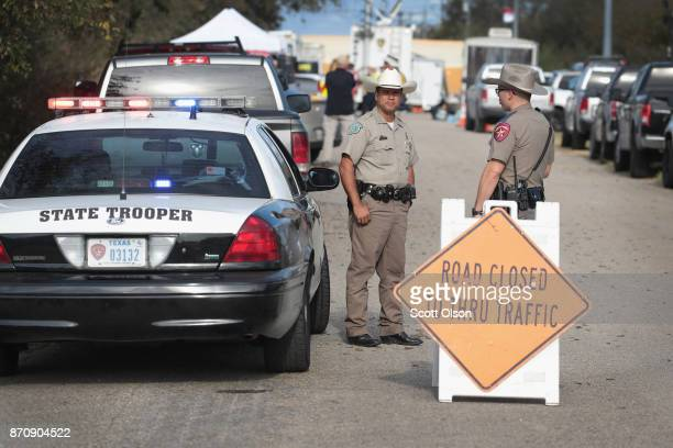 Law enforcement officials continue their investigation at the First Baptist Church of Sutherland Spring on November 6 2017 in Sutherland Springs...
