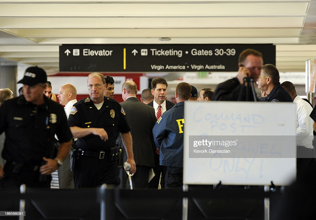 Law enforcement officials gather in between Terminals 2 and 3 after a shooting incident at Los Angeles International Airport (LAX) November 1, 2013 in Los Angeles, California. A man identified as Paul Ciancia reportedly pulled out an assault rifle in Terminal 3 of the airport and shot his way through security, killing one Transportation Security Administration (TSA) worker and wounding several others before being shot himself.