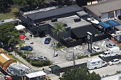 Law enforcement officials investigate at the Pulse gay nightclub where Omar Mateen allegedly killed at least 50 people on June 13 2016 in Orlando...