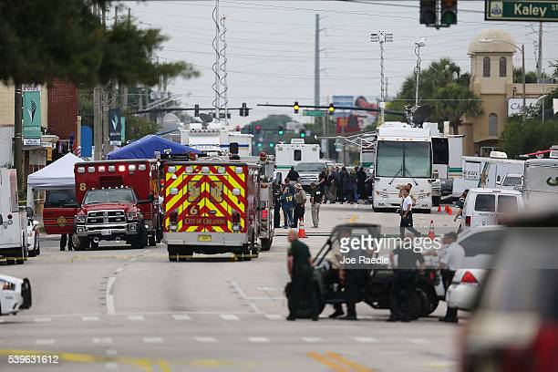 Law enforcement officials investigate near the Pulse Nightclub where Omar Mateen allegedly killed at least 50 people on June 12 2016 in Orlando...