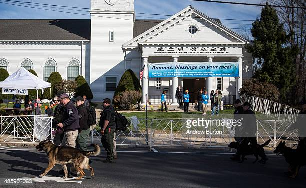 Law enforcement officials patrol the start of the Boston Marathon with dogs on April 21 2014 in Hopkington Massachusetts Today marks the 118th Boston...