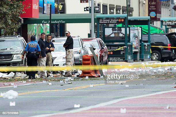 Law enforcement officials work at the scene of Saturday night's explosion in the Chelsea neighborhood of Manhattan September 18 2016 in New York City...