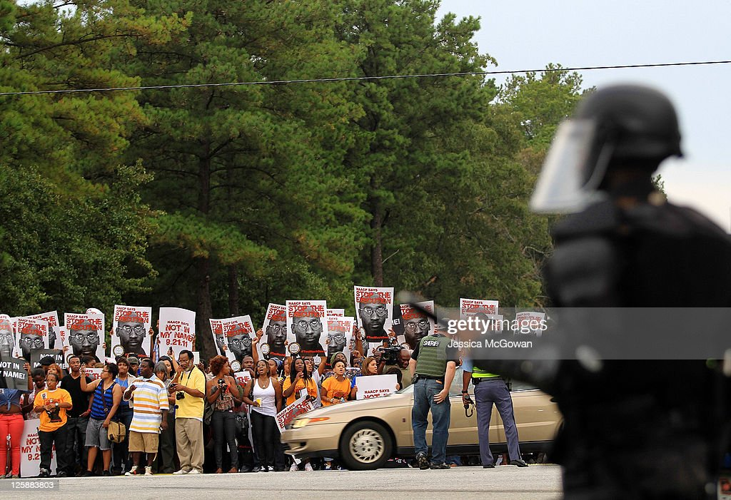 Law enforcement secure the prison entrance as protestors gather across from Jackson State Prison for the planned execution of inmate Troy Davis on September 21, 2011 in Jackson, Georgia. The Georgia Board of Pardons and Paroles denied clemency for death row inmate Troy Davis on Tuesday morning. Davis is scheduled for execution at 7pm on Wednesday, September 21, 2011 for the 1989 slaying of off-duty Savannah, Ga., police officer Mark MacPhail. Controversy over Davis' guilt has drawn national attention to the case.