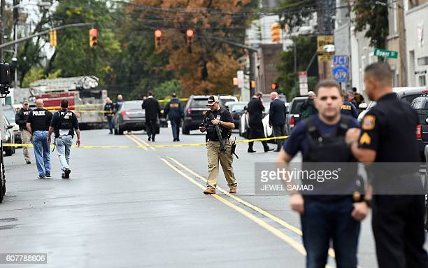Law inforcement officers secure the area where they allegedly arrested terror suspect Ahmad Khan Rahami following a shootout in Linden New Jersey on...