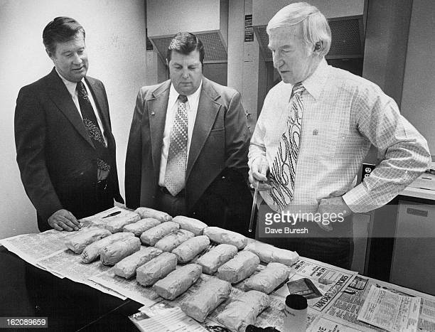 MAR 1 1978 Law Officials Inspect Packages Of Suspected Heroin Seized Tuesday At Alamosa From left Jim Burke deputy regional director of the Drug...