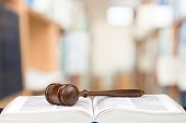 Wooden judge gavel and book close-up view