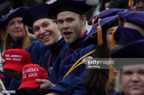 Law school graduates Brock Bales of Dallas Texas and Tyler Owens of Fort Worth Texas show their 'Make America Great Again' caps prior to the...