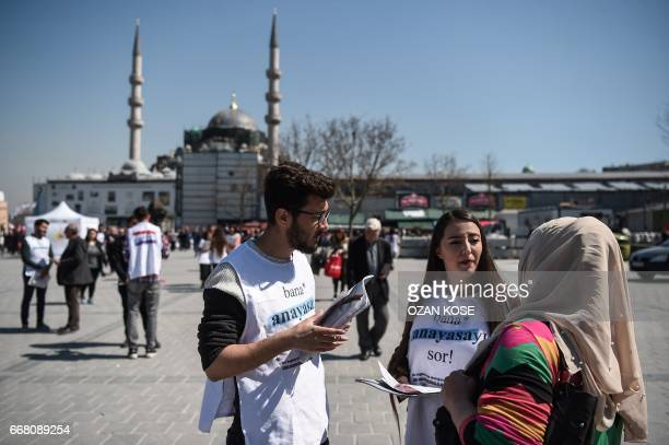 Law student explain people about the new constitution proposal on April 11 2017 at Eminonu district in Istanbul as the countdown starts for the April...