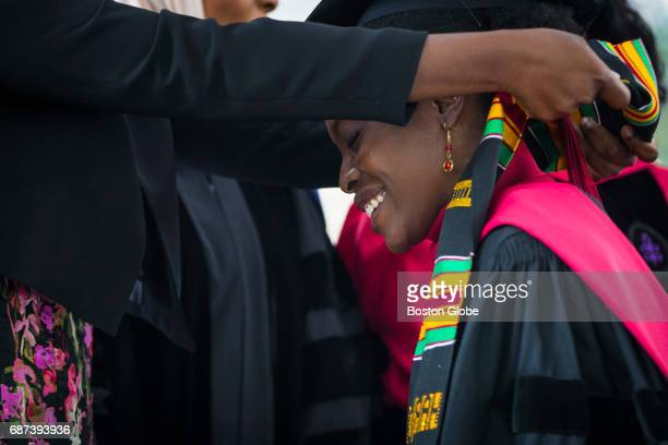 Law Student graduate Esther Agbaje smiles as she has a stole made of African kente cloth draped around her neck as she takes part in the Black...
