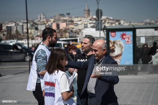Law students explain people about the new constitution proposal on April 11 2017 at Eminonu district in Istanbul as the countdown starts for the...