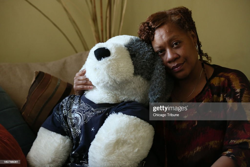 Lawanda Sterling, who's son Jeremiah Sterling was shot and killed on July 15, 2010 in an alley, poses for a portrait with stuffed bear that wears her son's shirt, February 1, 2013 at her home in Chicago. Jeremiah had moved from Chicago to get away from the violence however, he was shot and killed after returning to visit his family.