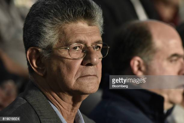 Lawmaker Henry Ramos Allup listens during a press conference held by the opposition coalition announcing the goals of a transitional government in...