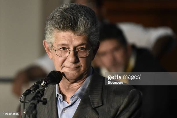 Lawmaker Henry Ramos Allup pauses while speaking during a press conference held by the opposition coalition announcing the goals of a transitional...