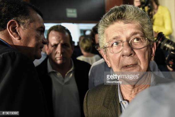 Lawmaker Henry Ramos Allup right leaves following a press conference held by the opposition coalition announcing the goals of a transitional...