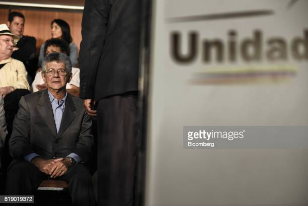 Lawmaker Henry Ramos Allup sits during a press conference held by the opposition coalition announcing the goals of a transitional government in...