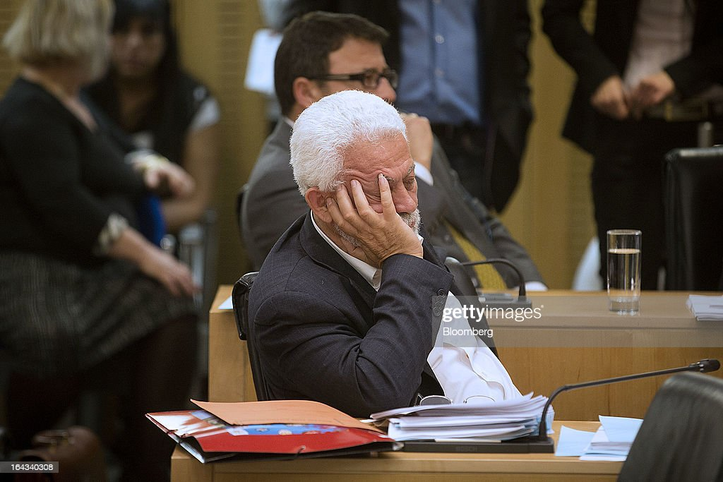 A lawmaker reacts during a debate on the nation's banking crisis inside the Cypriot parliament in Nicosia, Cyprus, on Friday, March 22, 2013. The aid package Cyprus is seeking would only provide temporary relief as it risks triggering a capital flight that would push the nation closer to needing to restructure its debts. Photographer: Simon Dawson/Bloomberg via Getty Images