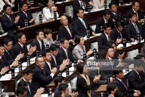 Lawmakers applaud as Yukio Hatoyama Japan's prime minister delivers his policy speech at the lower house of the Diet in Tokyo Japan on Monday Oct 26...