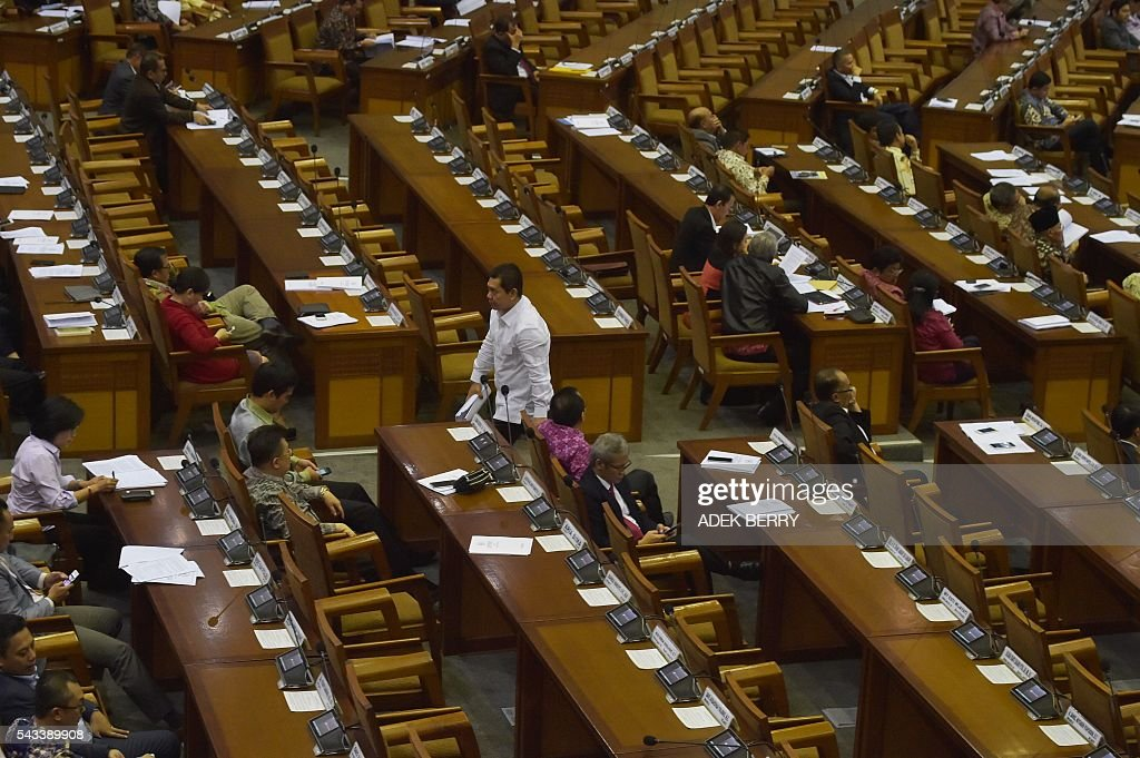 Lawmakers attend a plenary session for a tax amnesty bill at the parliament in Jakarta on June 28, 2016. Indonesia's parliament on June 28 passed a tax amnesty bill in a bid to give Southeast Asia's top economy a multi-billion-dollar boost, defying criticism the move will let evaders off the hook. BERRY