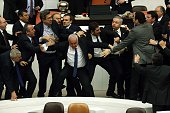 Lawmakers from the main opposition Republican People's Party and ruling AK Party scuffle during a debate on a legislation to boost police powers at...